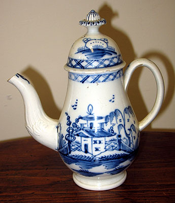 Ceramics<br>18th Century<br>A diminutive Pearlware Blue and White coffeepot