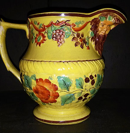 Ceramics<br>Ceramics Archives<br>SOLD Yellow-glazed jug with masks
