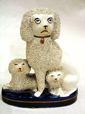 Ceramics<br>Ceramics Archives<br>SOLD A Pair of Staffordshire Poodles wtih Puppies