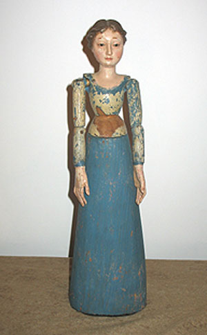 Accessories<br>Accessories Archives<br>SOLD   A Carved Wood Figure of a Woman