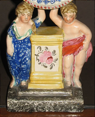 Accessories<br>Archives<br>SOLD   A CHARMING FIGURAL WATCH HOLDER
