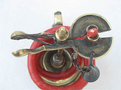 Metalware<br>Archives<br>An 18th century Brass Waxjack