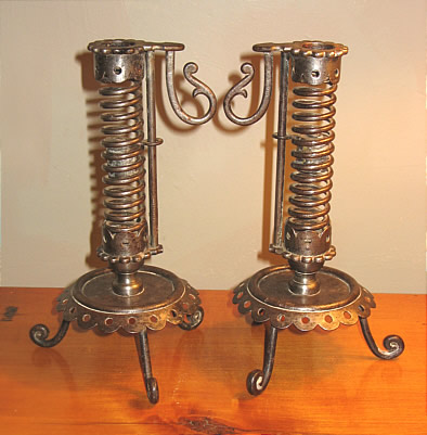 Metalware<br>Archives<br>PAIR OF IRON PIGTAIL CANDLESTICKS