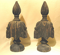 SOLD   A Spectacular Pair of Flame-top Carved Urns