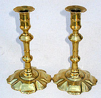 A Pair of Queen Anne Brass Candlesticks