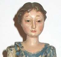 SOLD   A Carved Wood Figure of a Woman