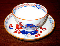 SOLD  A Lowestoft Soft Paste tea bowl and saucer.