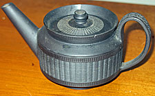 SOLD  One cup, or toy sized, engine turned basalt teapot