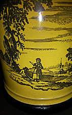 Yellow-glazed mug with black transfer