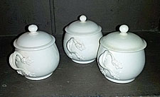 Three Creamware covered custard cups