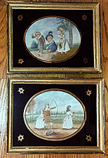 Pair of silk needlework pictures of children playing