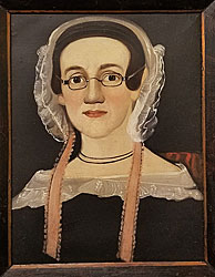 Portrait of a lady wearing glasses.