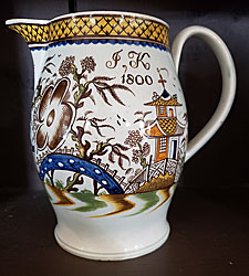 Pearlware polychrome dated jug