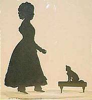 SOLD   Edouart silhouette of young girl and her dog.