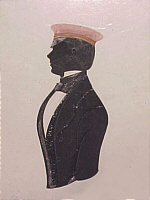 SOLD   Silhouette of a young man in a red cap.