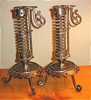 PAIR OF IRON PIGTAIL CANDLESTICKS
